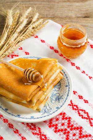 maslenitsa: Stack of crepes russian blini with honey for Maslenitsa