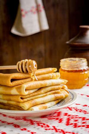 blini: Stack of pancakes with honey. Russian blini for Maslenitsa