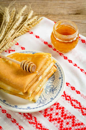blini: Stack of crepes russian blini with honey for Maslenitsa