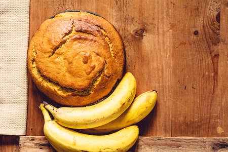 banana bread: Banana bread loaf on wooden table. Copy space for text