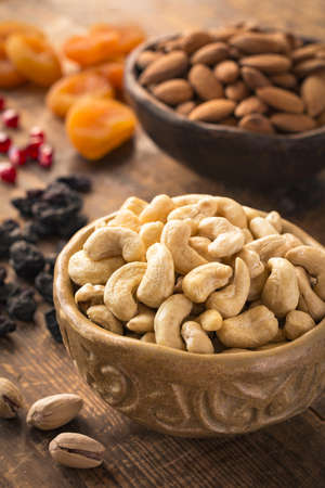 hazelnuts: Cashews, pistachios, almonds, raisins, pomegranate seeds and dried apricots. Turkish dried fruits and nuts. Variety of dried fruits and nuts Stock Photo