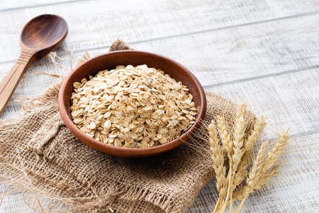 Oats, rolled oats or oat flakes in bowl. Healthy eating, healthy lifestyle concept Stock Photo