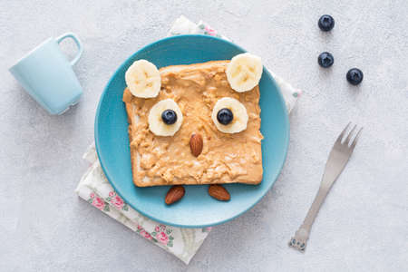 Peanut butter toast shaped as cute owl. Healthy creative breakfast food for kids