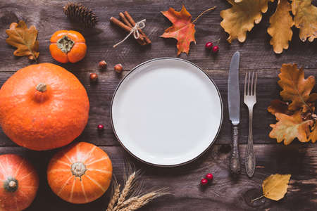 #85984474 - Autumn or thanksgiving day table setting. Fallen leaves pumpkins spices empty plate and vintage cutlery on wooden table. & Autumn Halloween Or Thanksgiving Day Table Setting. Fallen Leaves ...