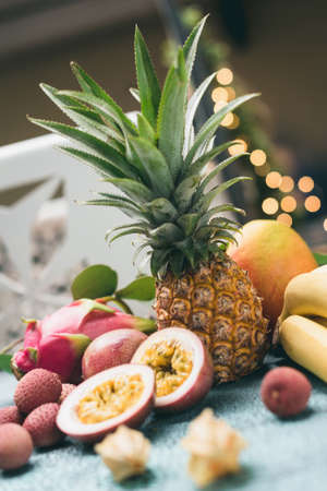 Tropical fruits ananas, lychee, bananas, kiwi, passion fruit and others. Toned image Selective focus Stock Photo