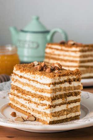 Honey cake Medovik on white plate. Closeup view, toned image
