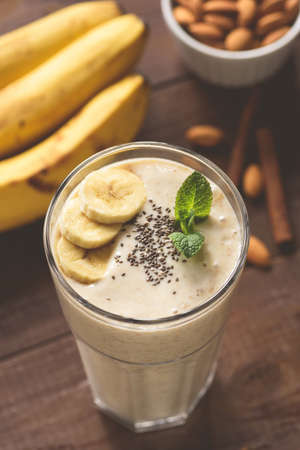 Vegan banana smoothie with chia seeds in glass. Concept of healthy eating, dieting, detox, healthy lifestyle and fitness menu