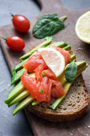 Toast with avocado and smoked salmon. Healthy snack