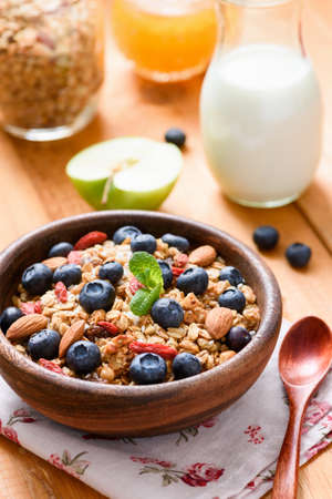 Homemade granola with berries for healthy breakfast. Healthy eating, healthy lifestyle, dieting and balanced breakfast meal concept Фото со стока