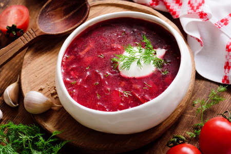 Borscht soup in white bowl with sour cream. National Ukrainian and Russian cuisine food. Closeup view Фото со стока