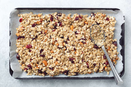 Homemade granola on baking sheet. Table top view. Concept of healthy eating, dieting, healthy lifestyle and wellness Stock Photo