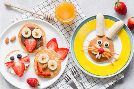 Colorful breakfast meal for kids. Funny Easter food art, top view. Concept of healthy eating, baby food, healthy breakfast food