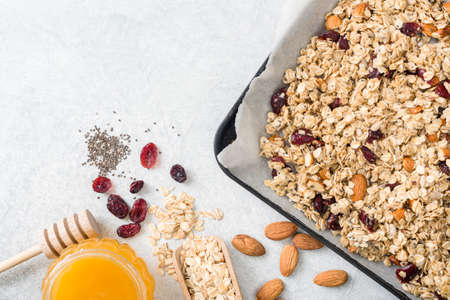 Homemade granola ingredients with copy space for text. Oats, nuts, honey, chia seeds and dry fruit for making granola, muesli, energy bars. Healthy lifestyle, vegan, vegetarian, clean eating, dieting, fitness concept Stock Photo
