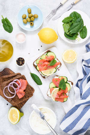 Salmon appetizer sandwiches with cream cheese and cucumber. Mediterranean breakfast. Top view