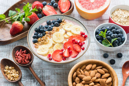 Acai Smoothie bowl with granola, banana, strawberry and blueberries. Superfood. Concept of healthy eating, healthy lifestyle, fitness, dieting, vegan vegetarian