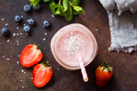 Vegan Fruit smoothie with coconut milk. Top view selective focus. Concept of healthy lifestyle, healthy eating, vegan diet
