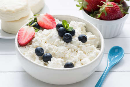 Curd cheese, farmer cheese, tvorog or quark fresh berries in a bowl. Healthy lifestyle, healthy eating food Stock Photo