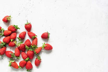 Fresh strawberry. Strawberries on white concrete background. Harvest of organic local strawberries