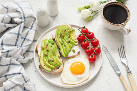 Breakfast with avocado toast, egg and coffee. Healthy breakfast, healthy lifestyle concept