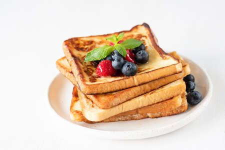 French toast with berries isolated on white. Closeup view, selective focus Stock Photo