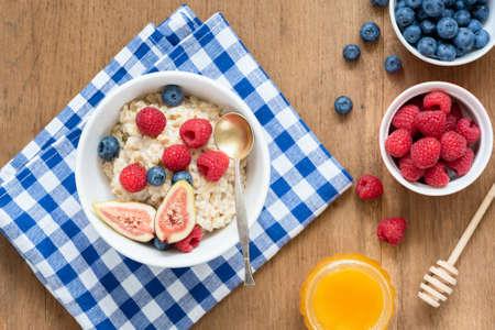 Breakfast Oatmeal Porridge WIth Fruits Berries Honey. Table Top View. Healthy Breakfast Food