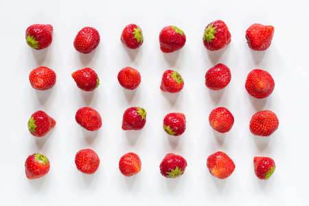 Strawberries flat lay on white. Pattern of fresh tasty strawberries isolated on white background