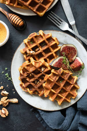 Belgian waffles and figs on a plate. Top view of tasty breakfast waffles
