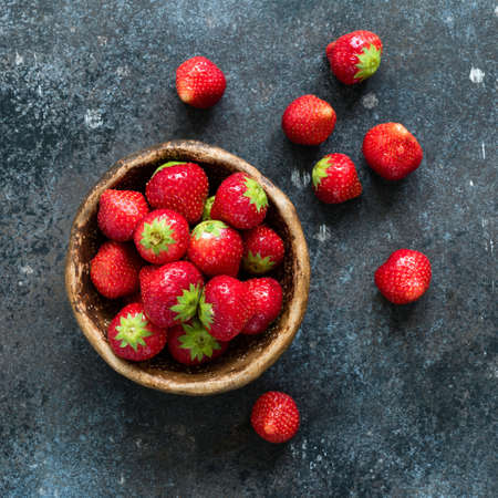 Fresh strawberries in a bowl. Top view, square crop. Healthy sweet food, dessert or snack Stock Photo