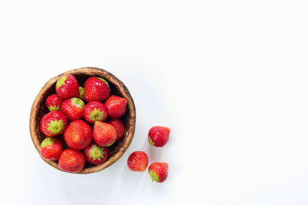 Strawberries in bowl on white background with copy space for text. Fresh tasty strawberries. Horizontal
