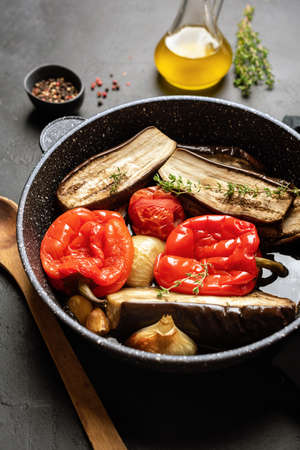 Roasted vegetables on a grill pan. Red Bell Pepper, Eggplant, Onion, Zucchini grilled