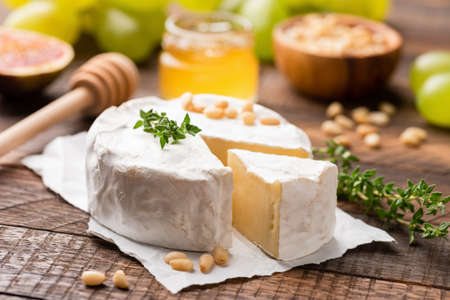 Camembert or Brie cheese served with honey, pine nuts, grapes and figs.