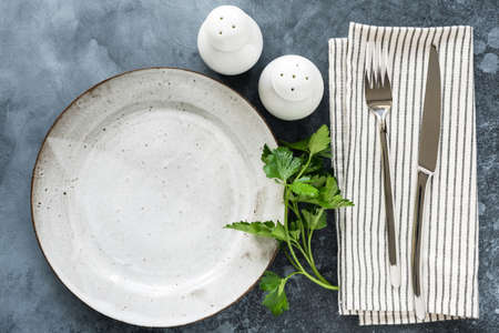 Table setting with empty plate, cutlery and table textile. Top view, copy space for text. Restaurant, food menu, cafe concept Фото со стока