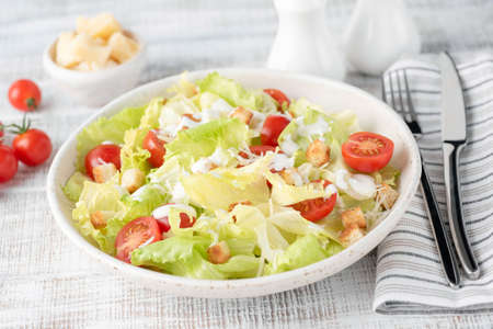 Caesar salad on white plate, closeup view, selective focus 스톡 콘텐츠