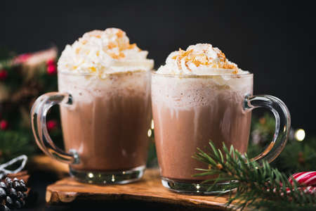 Christmas Hot Chocolate With Whipped Cream In Mug. Decorated With Golden Sugar Stars. Festive Christmas or Winter Holidays Drink, Comfort Food Concept