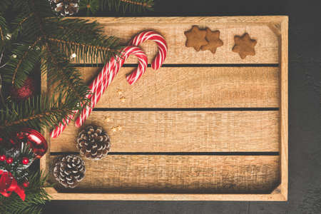 Christmas Background Wooden Box Candy Cane Fir Tree. Top View, Copy Space For Text. Winter Holidays Frame Background Stock Photo