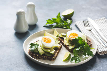 Healthy breakfast toast with avocado and egg. Selective focus