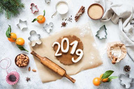 2019 numbers gingerbread cookies New Year baking concept. Фото со стока