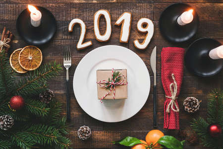 Table Setting Authentic New Year 2019 on rustic wooden table