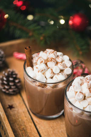 Hot Chocolate With Marshmallows Cinnamon on wooden