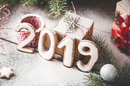 Happy New Year 2019 numbers, gift box and artificial snow