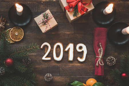New Year or Christmas table setting with 2019 letters. Winter holidays greeting card. Top view. Authentic table setting