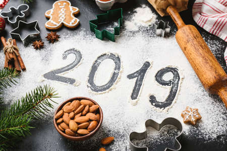 2019 New Year greeting written on flour. Winter holidays still life composition
