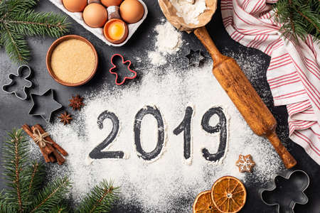 New Year 2019 written on flour. Baking Christmas gingerbread cookies. Top view