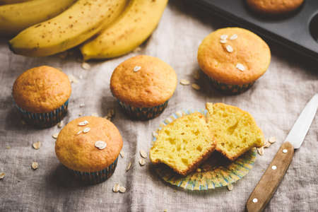Healthy oat banana muffins on table. Muffin cut in halves