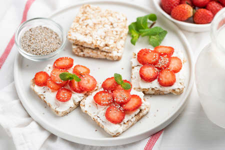Rice crisp bread with strawberries and cottage cheese. Healthy breakfast food, dieting, fitness menu and kids food