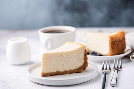 Classical New York Style Cheesecake And Coffee On Table. Side View. Coffee and Cake Фото со стока