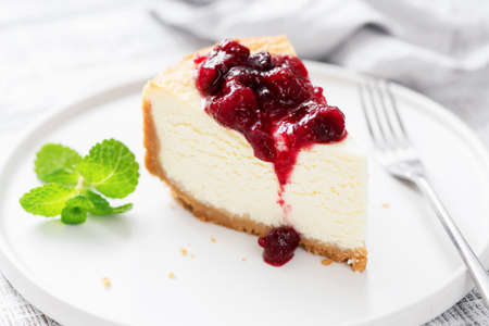 Classic Cheesecake With Cherry Sauce On White Plate. Tasty Delicious Dessert Cream Cake
