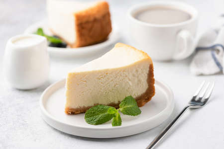 Tasty Cheesecake with Coffee on white plate. Cake and coffee. Coffee time. Selective focus