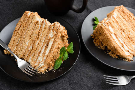Tasty Layered Honey Cake Medovik On Black Plate. Closeup View 스톡 콘텐츠