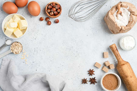 Baking ingredients and utensils on concrete background. Cooking or baking cake, cookies, pastry or bread concept. Top view with copy space for text, recipe, menu